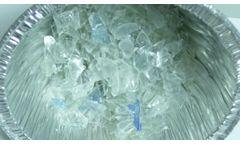 COMMINUTION OF PLASTIC BEVERAGE BOTTLES