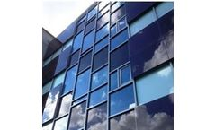 Photovoltaic Glass Panels for Solar Building-Integrated PV Façades and Glazing