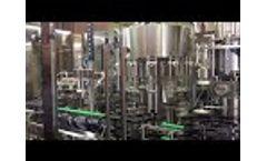 EcoPura Glass bottle washing filling capping machine Video