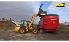 NDEco FS1400D Vertical Feed Mixer With Flotation Tires Barn Feeding - Video