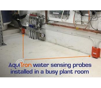 AquiTron water sensing probes installed in a busy plant room