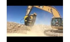 BF150.10, World`s Largest Crusher Bucket, Crushing Basalt and Gold ore on Cat 365 CL Video
