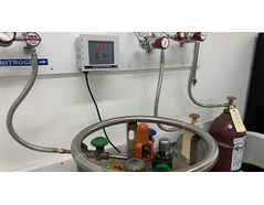 MODEL 221R Oxygen Deficiency Monitor installed in area with several gas cylinders