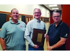 Jim McHugh (left), Ben Gleeson (middle), and George McHugh IV (Right) pose with the patent for the PURGEnVENT automatic air vent assembly.