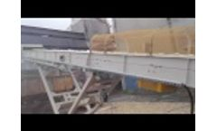 Unloading of wagon with moving conveyor Video
