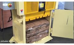 Small vertical cardboard baler machine with bale weight at 50-110kg, made in china by Skbaler - Video