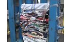 Pit press for baling used clothing - Video