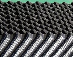 Rigid, corrugated structured polypropylene media provides substantial surface area for biomass attachment.