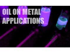 Oils extracted in solvent from steel screws fluoresce under UV light