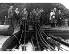 The picture below shows an early demonstration of OPEC oil skimmer devices.